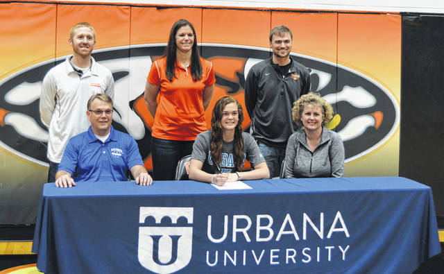Rob Kiser/Call Photo Versailles High School senior Kami McEldowney signed her letter of intent to play basketball for Urbana University Friday morning in the Versailles gym. In front with McEldowney are her parents Roger and Holly McEldowney. In back are assistant basketball coach Brian Shappie, basketball coach Jacki Stonebraker and athletic director Doug Gierre.