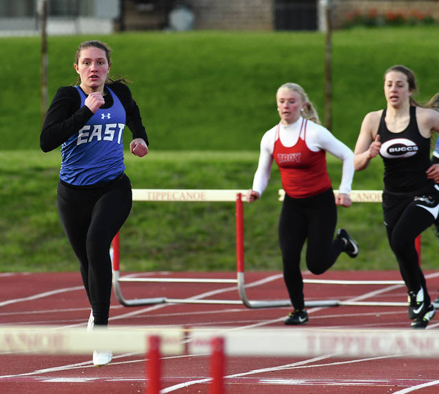 Ben Robinson/GoBuccs.com Miami East's Kaitlyn Mack leads the way in the 300-meter hurdles Tuesday.