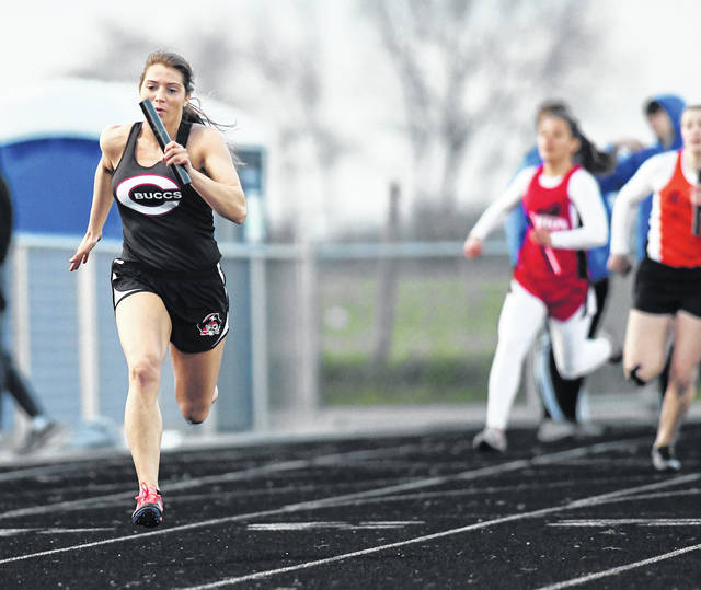 Ben Robinson/GoBuccs.com Covington's Shae Robinson leads the way in the 800-meter relay Friday.