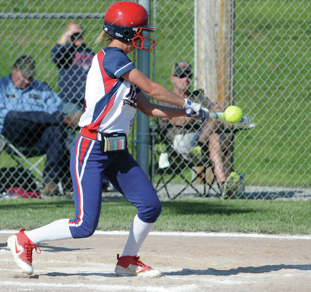 Piqua's Lilly Stewart slaps the ball against Troy Monday night.