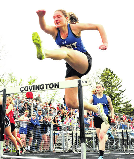 Viking Kaitlyn Mack runs the girls 100 meter hurdles on Friday at the Covington Invitational Track Meet.
