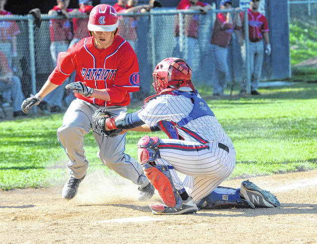 Piqua catcher Jan Adorno tags a Carroll runner out at the plate Tuesday.