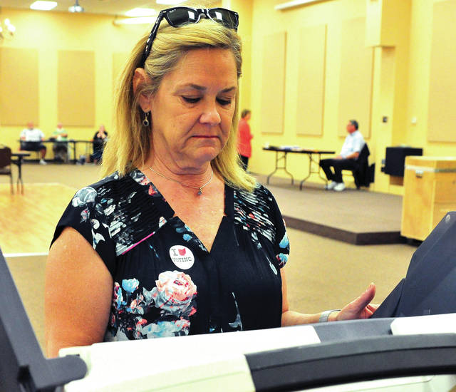 Mike Ullery | Daily Call Piqua Mayor Kazy Hinds casts her ballot at A Learning Place on Tuesday afternoon.