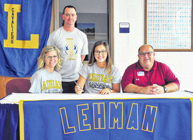 Mike Ullery/Call Photo Lehman Catholic senior Molly Safreed signed her letter of intent to play soccer at Adrian College Wednesday in the high school library. In front with her are here parents Melissa (left) and Mark (right). In back is Lehman Catholic varsity girls soccer coach Jeremy Lorenzo.