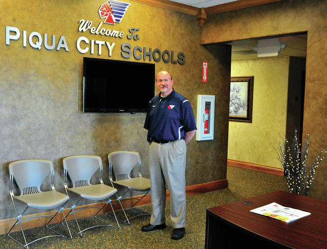 Mike Ullery | Daily Call Piqua City Schools superintendent Dwayne Thompson stands in the lobby of the new Piqua Board of Education offices located at 215 Looney Road. School board personnel are settling in to the former Sunrise Corporation Farm Co-Op. Thompson said the former owners donated all furnishings and equipment that was in the building, allowing Piqua City Schools staff to simply move their computers and a few essentials. Following a staff open house next week, a date for a public open house will be announced.