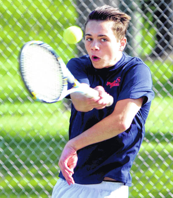 Mike Ullery/Daily Call Piqua's Demi Nicholas hits a return shot in D-I sectional tennis action at Troy City Park Wednesday.