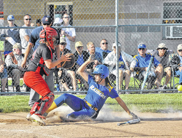 Josh Brown/Aim Media Photo Newton's Maddi Weaver waits for the throw as Russia's Lauren Monnin slides across the plate with a run Tuesday at Bradford.