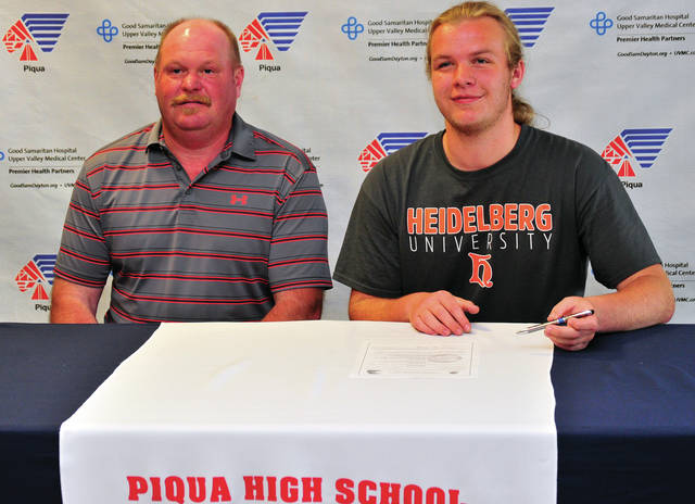 Mike Ullery/Daily Call Piqua High School senior Sean Hatke Piqua tennis player Sean Hatke, right, signs his letter of intent to attend Heidelberg University to play tennis. He is pictured with his father Tim. Not pictured is his mom Shonda.