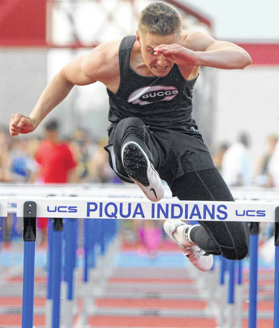 Covington's Cade Harshbarger runs in the 110 high hurdles Tuesday at Alexander Stadium/Purk Field.