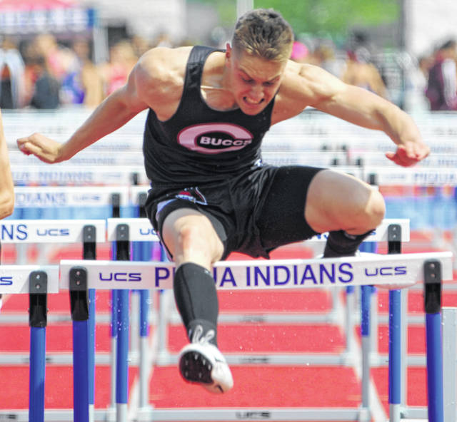 Mike Ullery | Daily Call Cade Harshbarger of Covington runs the boys 110 meter high hurdles