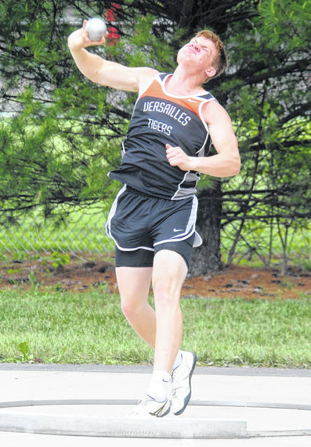 Mike Ullery   Daily Call A.J. Ahrens throws the shot for the Tigers in Division II District Track at Piqua on Saturday.