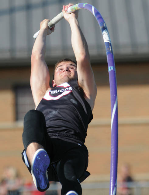 Covington's Jett Murphy works the pole during pole vault competition Wednesday at the Troy D-III regional.