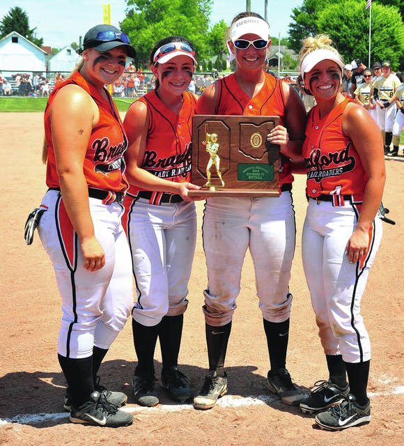 Mike Ullery/Call Photo Bradford seniors Aspen Weldy, Chelsea Gill, Bailey Wysong and Hannah Fout hold the D-IV regional championship trophy.