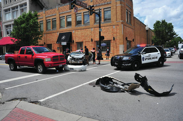 Mike Ullery | Daily Call Piqua police investigate a three-vehicle crash at the intersection of Main and Ash streets on Wednesday afternoon.