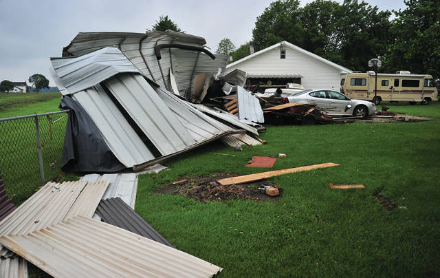 Mike Ullery | Daily Call The remains of an enclosed motor home canopy lay across the the ground behind a home in the 5200 block of State Route 18 following a Wednesday evening storm — that brought with it a tornado.