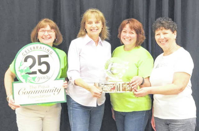 Provided photo Left to right are Karen Wendeln of the Piqua Community Foundation, Peggy Henthorn of Miami Valley Centre, Cindy Dobo of Dobo's Delights Bake Shoppe, and Marsha Koon, co-chair of Cakes for a Cause. Koon presented the People's Choice trophy to cake donor Henthorn and baker Dobo.