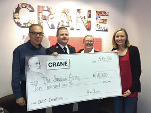 Provided photo Majors Robert and Jody Kramer, center, of the Salvation Army-Piqua, are presented with a $10,000 donation check by Brian P. Sweeney, president of Crane Pumps & Systems, and Julie Buschur, the company's vice president of human resources.