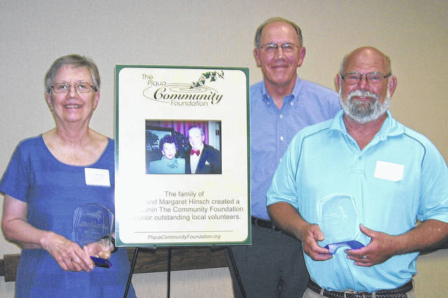 Provided photo Nancy Brogden, left, and Mark Casto, right, were honored for their community service with Hinsch Awards on Thursday by The Piqua Community Foundation. Brogden is the volunteer coordinator for the Greene Street United Methodist Church food pantry, and Casto designed, built and placed 13 raised gardens for the Garden Tribe Schoolyard Garden. The awards were created by the Hinsch family — which include John Hinsch, center — to honor their parents, the late Margaret and Scott Hinsch, who were active volunteers in Piqua for many years.