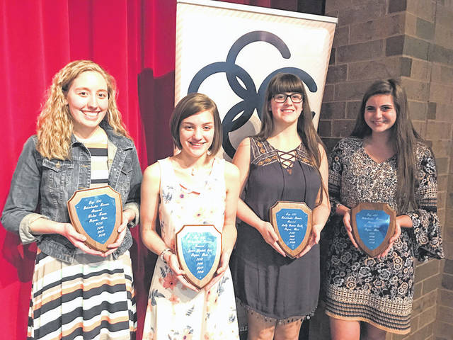 Provided photo Four-year recipients at the 54th annual Top 100 Scholastic Banquet were, left to right, Chloe Koon, Leanne Price, Molly Smith, and Darby Bubp. The event was hosted April 25 by the Piqua Area Chamber of Commerce.