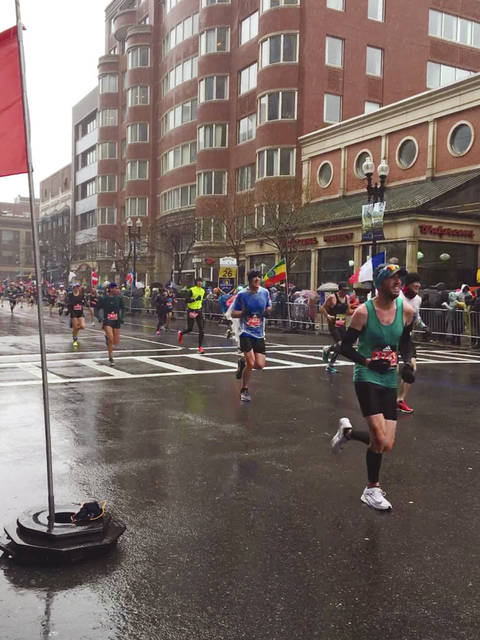 Provided photo Justin Perkins, front right, participates in his first Boston Marathon. Perkins is an athletic trainer at the UVMC Center for Sports Medicine in Tipp City and athletic trainer for Troy High School