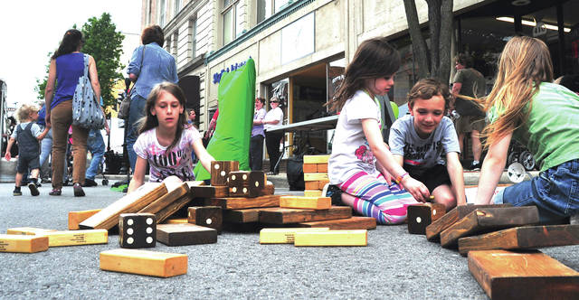 Mike Ullery | Daily Call Youngsters enjoyed activities in the Kids' Zone at last week's Taste of the Arts, which drew thousands to downtown Piqua.