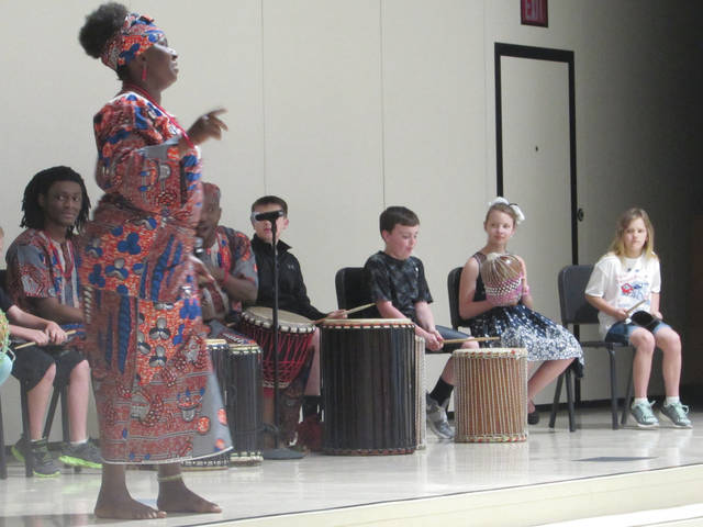 Sam Wildow | Daily Call Bi-Okoto Drum and Dance Company from Cincinnati performs Nigerian songs and dances with Piqua Central Intermediate Students on Monday evening.