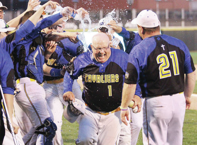 Luke Gronneberg/Aim Media Lehman baseball coach Dave King runs from his players as they dump water on him at Fifth-Third Field Thursday after King notched his 600th career baseball win after defeating Riverside.
