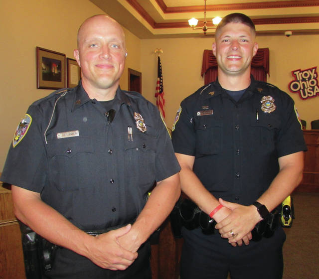 Melanie Yingst | AIM Media Midwest Sgt. Ryan Ormberg, left, and Sgt. Dominic Burnside, recently rose in the ranks of the Troy Police Department. Ormberg was officially promoted on Tuesday, May 29, and Burnside was officially promoted on Monday, May 21. Both are graduates of Piqua High School.