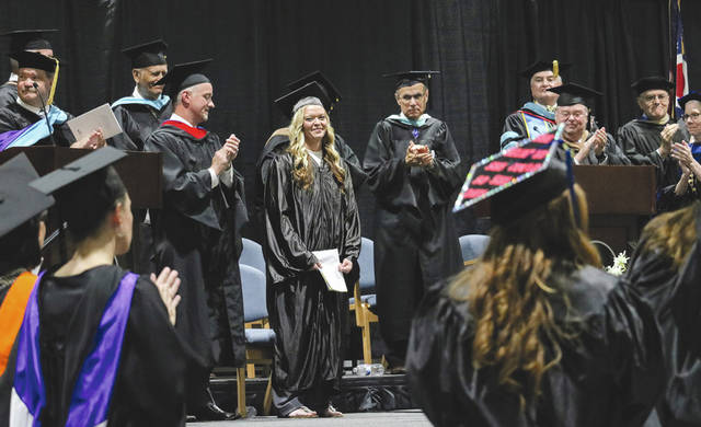 Provided photo Sunny Herring, phlebotomist and Edison State alumna, receives a standing ovation following her keynote address at Edison State Community College's 43rd Commencement Ceremony.