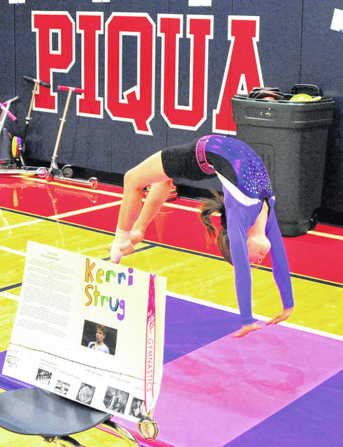Mike Ullery | Daily Call Washington Primary School third-grader Lindsay Bernard portrays U.S. Olympic gymnast Kerri Strug during Wax Museum Day on Thursday.