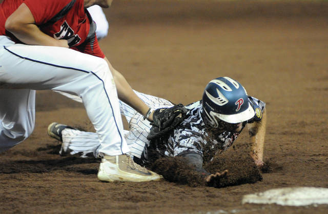 Call File Photo Michael Ashcraft dives back into first base for Post 184 in a game last season.