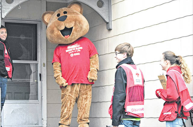 Provided photo Red Cross volunteers installed more than 100 free smoke alarms in Piqua homes on April 28.