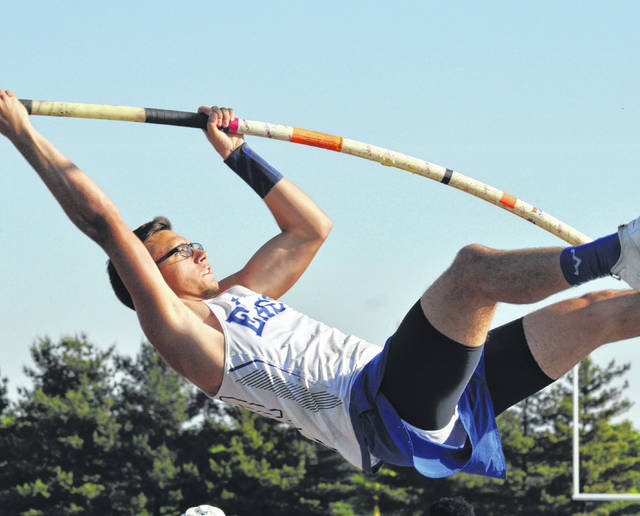 Rob Kiser/Call Photo Miami East's Blaine Brokschmidt elevates himself towards the bar in the pole vault.