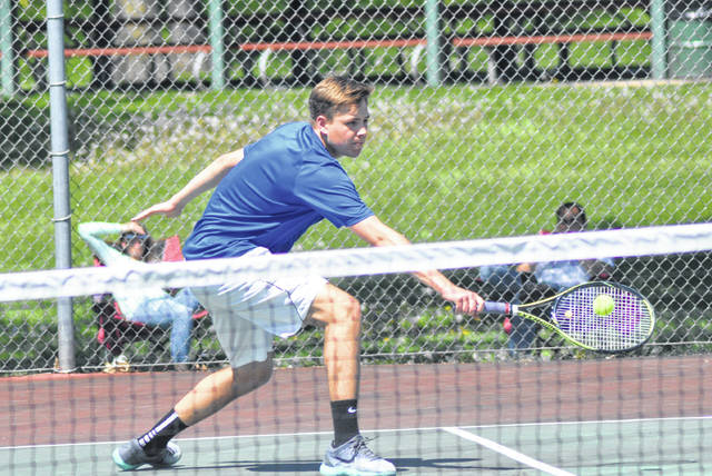 Rob Kiser/Call Photo Lehman Catholic's Griffin West makes a backhand return against Tippecanoe's Hugo Mark Tuesday.