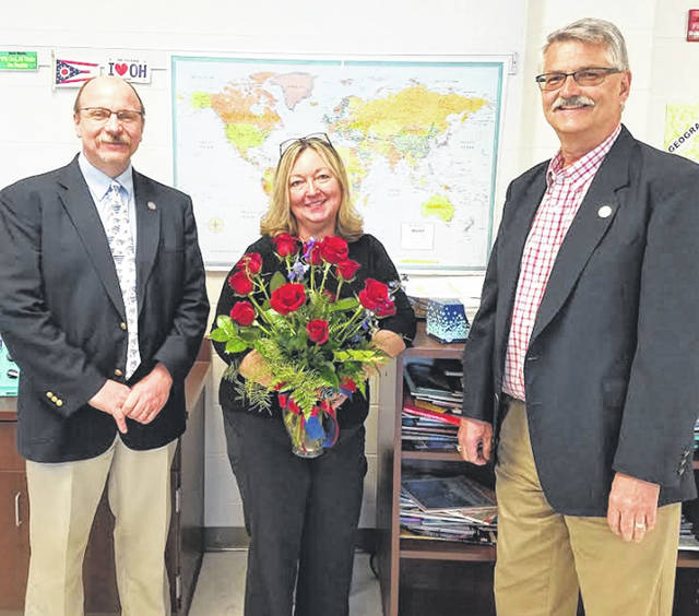 Provided photo Stacy Patton, a 25-year member of the Piqua City Schools teaching staff, has been named Teacher of the Year. Patton, who currently teaches fourth grade social studies at Piqua Central Intermediate, is shown above with PCS Superintendent Dwayne Thompson, left, and Board of Education President Andy Hite.