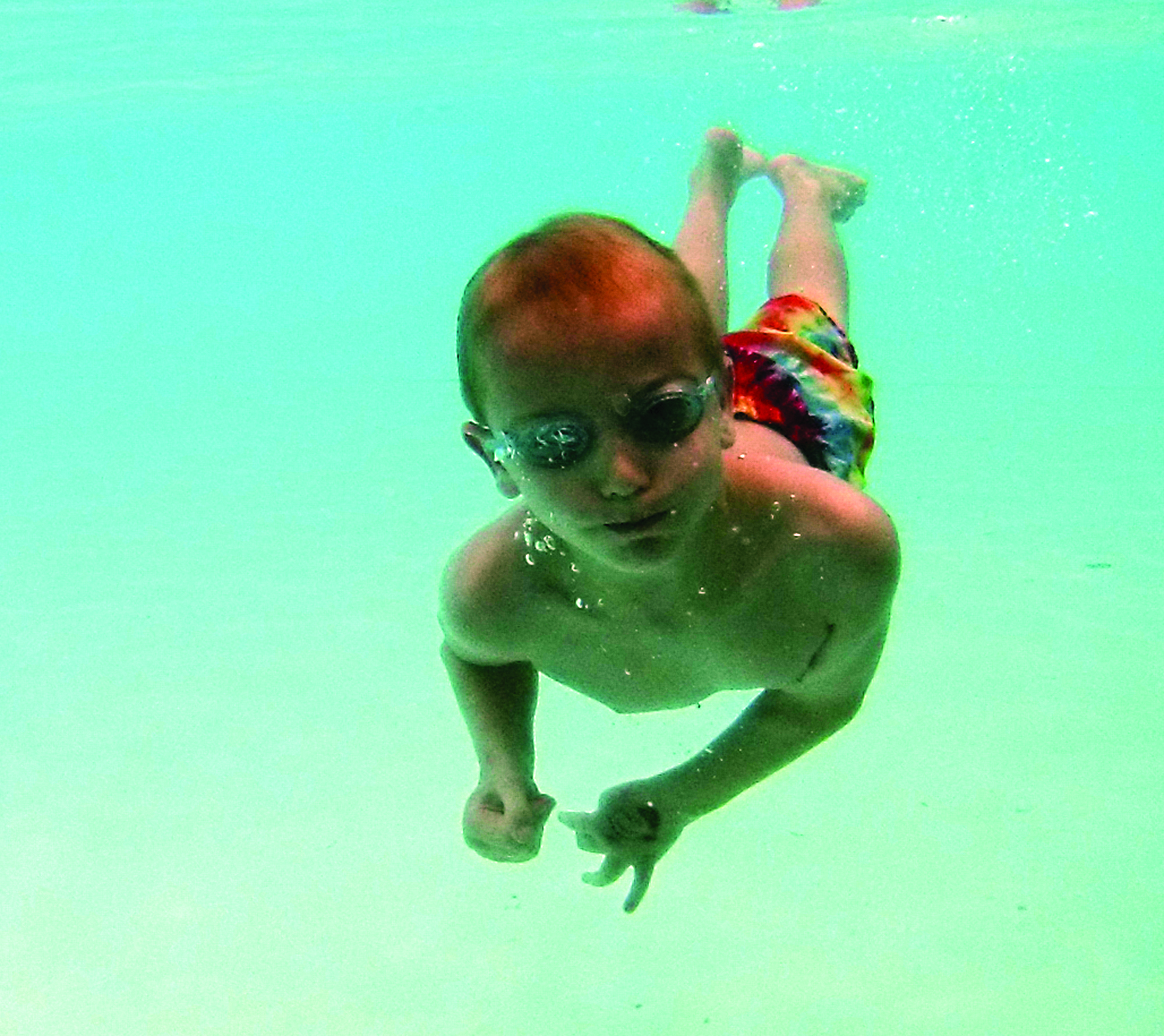 Mike Ullery | Daily Call file photo Eight-year-old Silas Herndon of Piqua shows off his underwater swimming skills at the Piqua City Swimming Pool in July 2017.