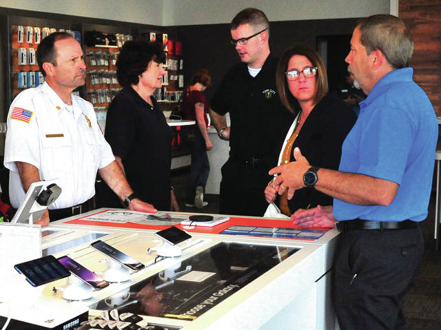 Mike Ullery | Daily Call Piqua Fire Chief Brent Pohlschneider, Joanna Pittenger and Michael Whitby of Tipp City EMS, Catherine Bogan, HR Director for the City of Piqua, and Tom Chilelli, a sales rep for Samsung, talk technology during Thursday's AT&T First Responders Appreciation Day at their East Ash Street location in Piqua.
