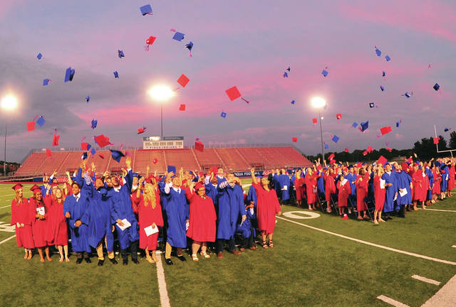 Mike Ullery | Daily Call Hats flying into the air bringing to an end the high school careers of the Piqua High School Class of 2018 during commencement ceremonies at Alexander Stadium/Purk Field on Friday.