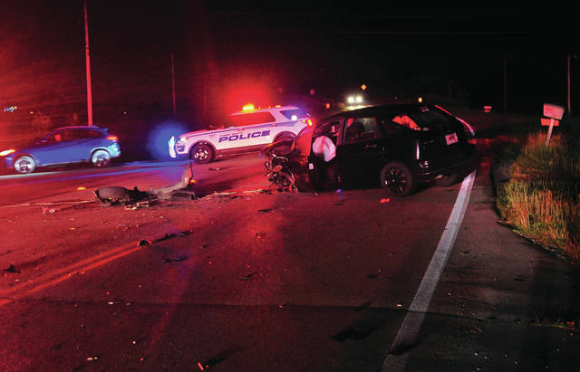Mike Ullery | Daily Call Tipp City police investigate a crash at the intersection of Peters and Monroe-Concord Road on Tuesday evening.