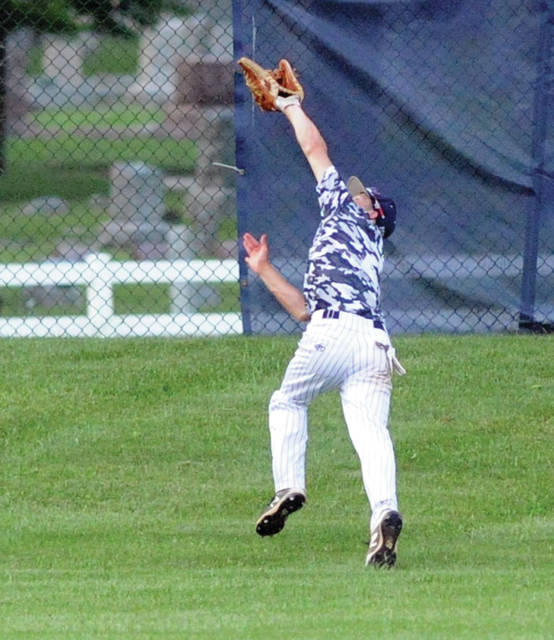 Piqua Post 184's Cory Cotrell makes a running catch in centerfield against Van Wert Tuesday night at Hardman Field.