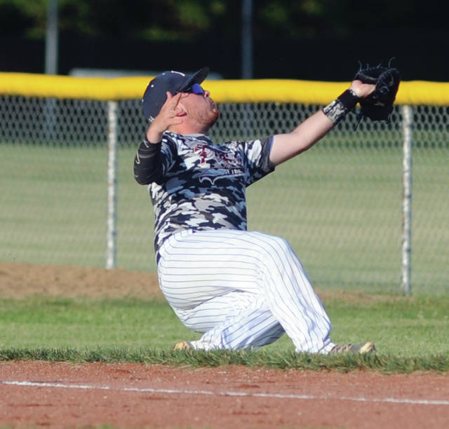 Piqua Post 184 first baseman Logan Harris makes a catch in foul territory against Sidney Wednesday.