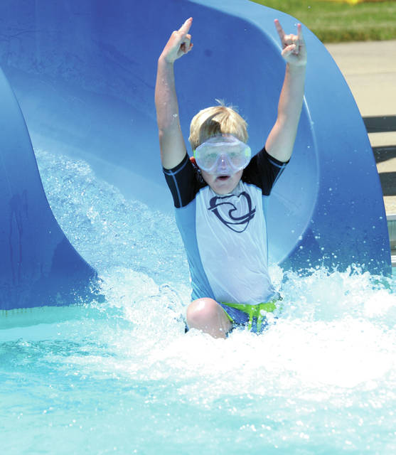Ronnie Kennet, 6, of Bradford shows some style as he comes off the water slide at the Piqua City Pool this week.