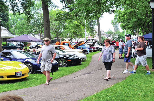 Mike Ullery | Daily Call Visitors to Fountain Park check out the show cars at the Miami Valley Corvette Clubs annual Car Show on Saturday. More than 50 vehicles were on display throughout the afternoon.
