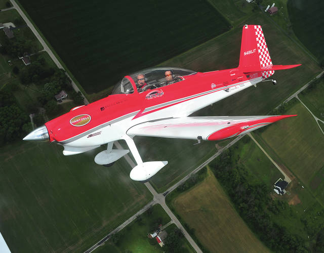 Mike Ullery | Daily Call Jon Thocker, front, of Red Line Air Shows, and Ricardo Von Puttkammer of Aviation Photojournal in New York, make a tight turn over the countryside during a flight on Friday at the 2018 Vectren Dayton Air Show. Thocker and his teammate Ken Rieder will be performing in their RV-8 aircraft on Saturday and Sunday.