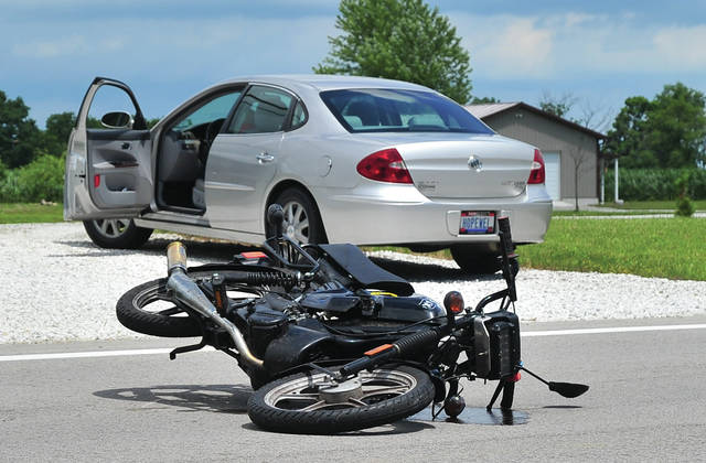 Mike Ullery | Daily Call A moped lays on its side on St. Rt. 66 at Demming Road on Wednesday afternoon after it was struck by a car.