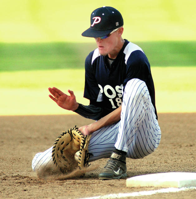 Piqua Post 184 first baseman Austin Rutledge digs the ball out of the dirt Friday night against Springfield Armoloy in the Piqua Post 184 Invitational at Hardman Field.