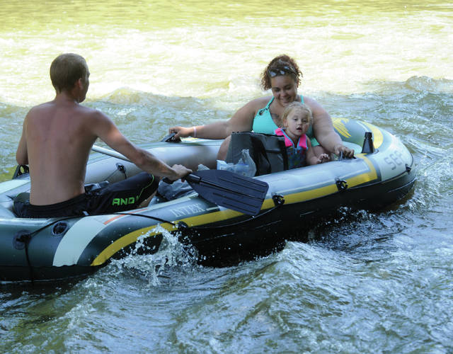 Mike Ullery | Daily Call A family beat the heat on Saturday with a float trip down the Great Miami River near the Miami County Park District's Twin Arch Park.