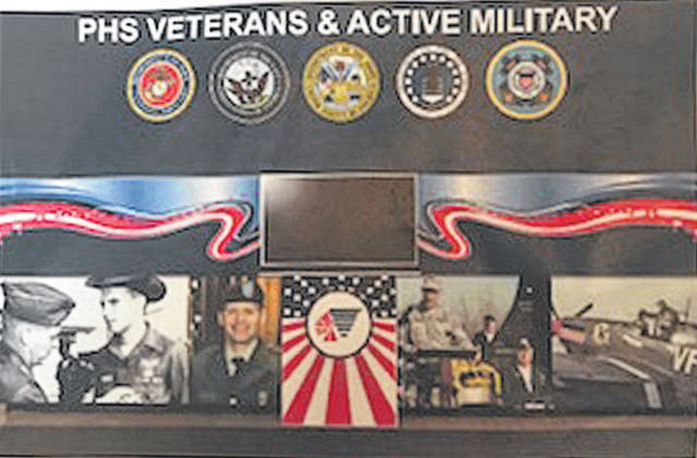 Provided photo A mock-up of what part of the veterans' wall at Piqua High School might look like. The display honoring PHS grads who joined the military is projected to be completed this fall.