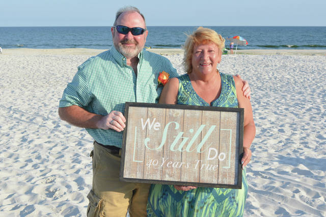 Provided photo Mr. and Mrs. Douglas Ditmer of Piqua recently celebrated their 40th anniversary in Gulf Shores, Alabama.