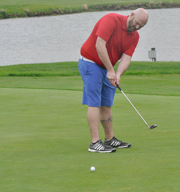Rob Kiser/Call File Photo Brian Robbins watches a putt on the second green at Echo Hills recently.